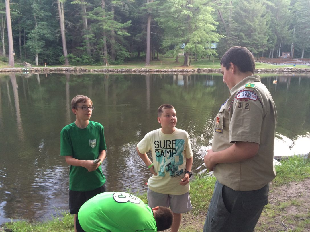 Staff conversing with scouts